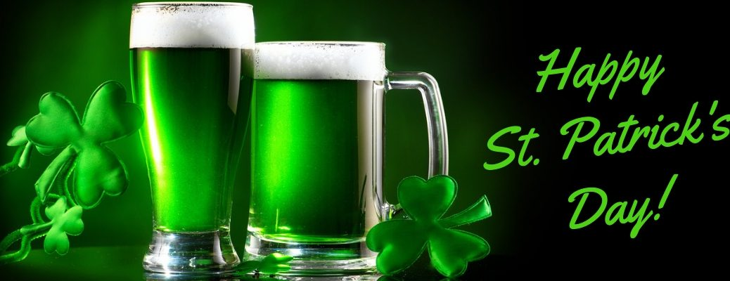 Green Beer and Shamrocks on Black Background with Green Happy St. Patrick's Day! Text