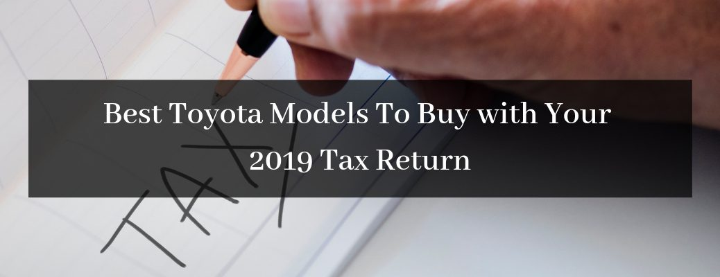 Close Up of Hand and Pencil Writing TAX with Black Rectangle and White Best Toyota Models To Buy with Your 2019 Tax Return Text