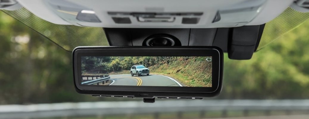 Close Up of 2019 Toyota RAV4 Digital Rearview Mirror Showing a Vehicle on the Road Behind
