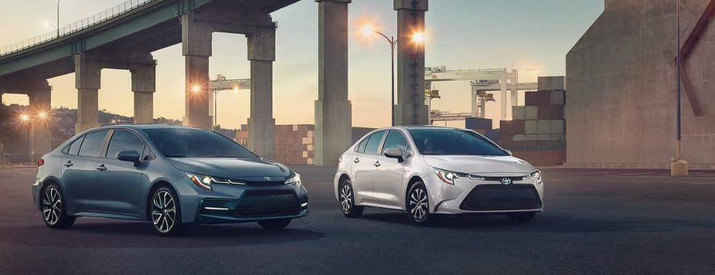 Gray and White 2020 Toyota Corolla Models By a Bridge at Twilight
