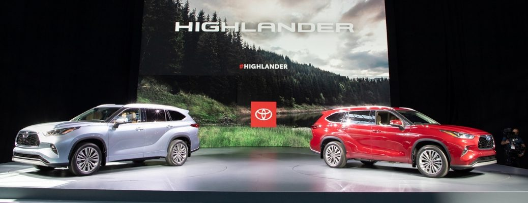 Blue and Red 2020 Toyota Highlander Models on Stage at Auto Show