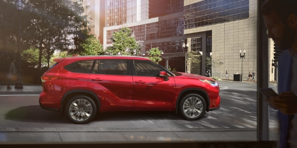 Red 2020 Toyota Highlander Side Exterior on a City Street