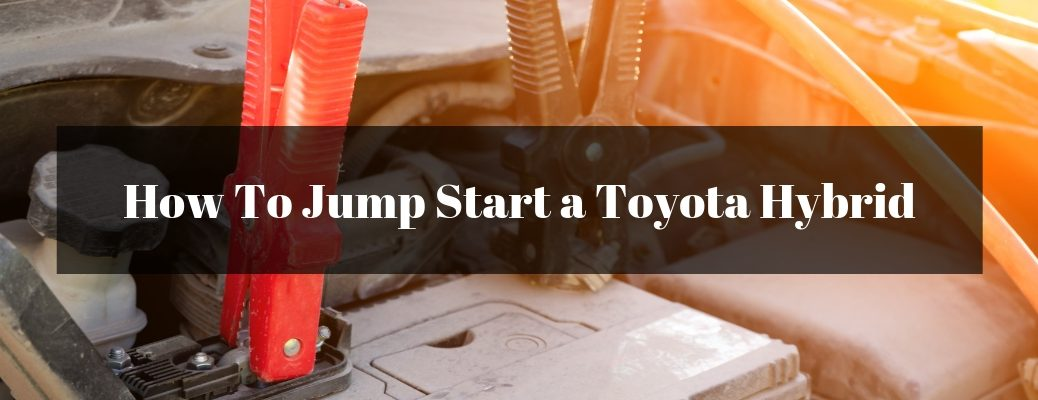 Close Up of Jumper Cables on a Battery with Black Text Box and White How To Jump Start a Toyota Hybrid Text