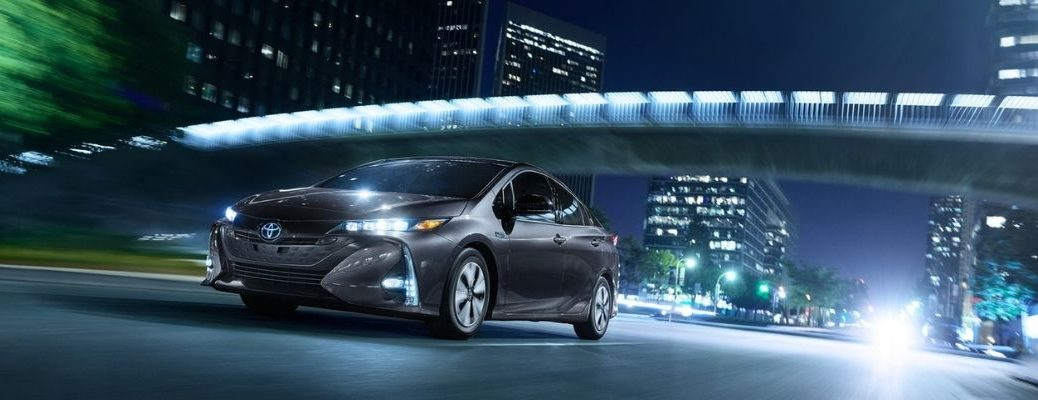 Gray 2019 Toyota Prius Prime on a City Street at Night