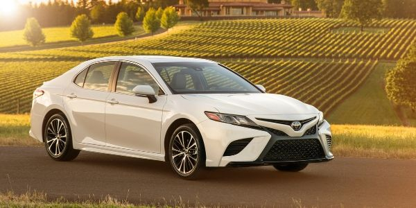 White 2018 Toyota Camry on a Farm