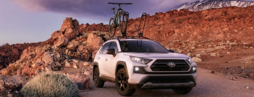 White 2020 Toyota RAV4 TRD Off-Road on Trail with Bike Rack and Bikes