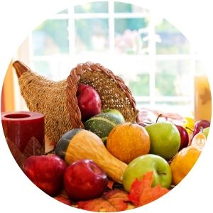 Thanksgiving Cornucopia on a Table with Fruits and Vegetables