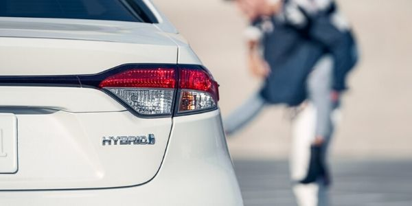 Close Up of 2020 Toyota Corolla Hybrid Badge on White Exterior