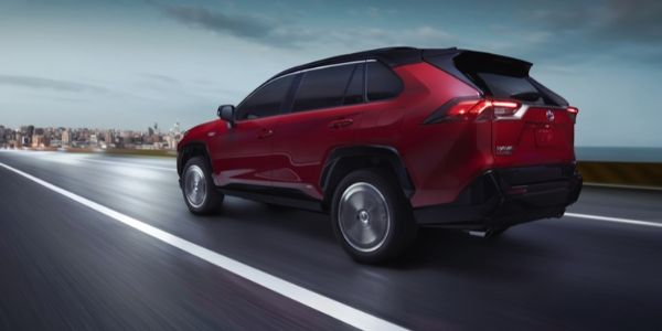 Red 2021 Toyota RAV4 Prime Rear Exterior on a Highway