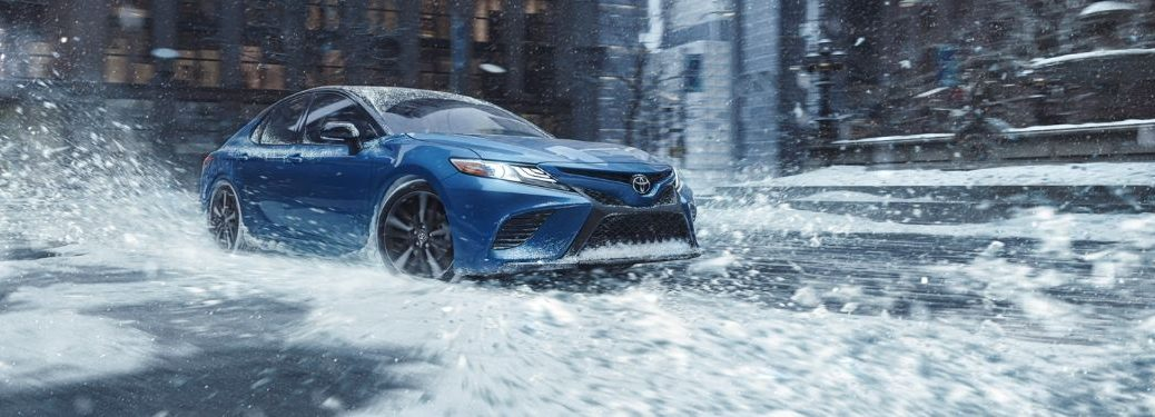Blue 2020 Toyota Camry with AWD Driving in Snow