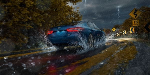 Blue 2020 Toyota Camry AWD Rear Exterior Driving in the Rain