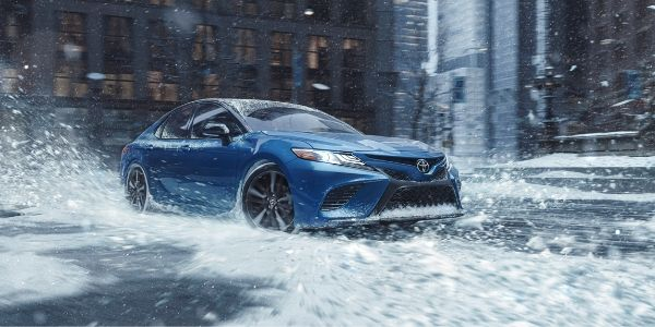 Blue 2020 Toyota Camry Driving in Snow