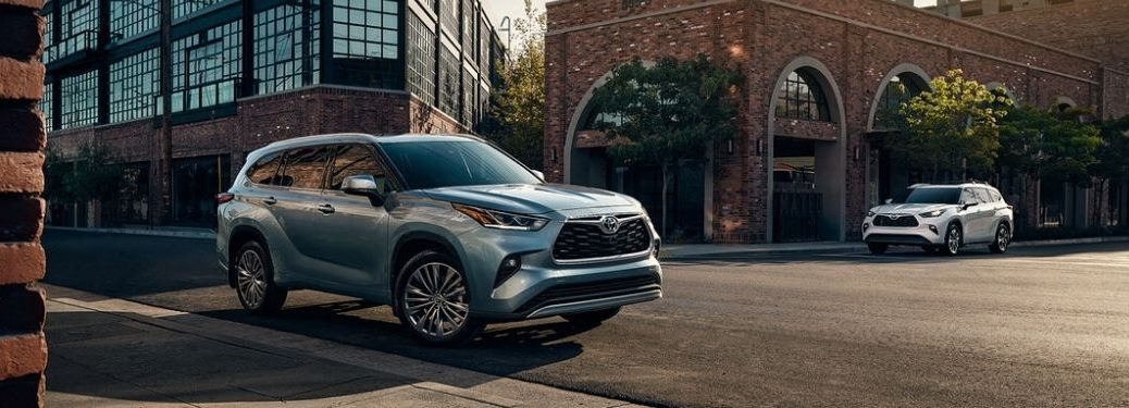 Blue and White 2020 Toyota Highlander Models on a City Street