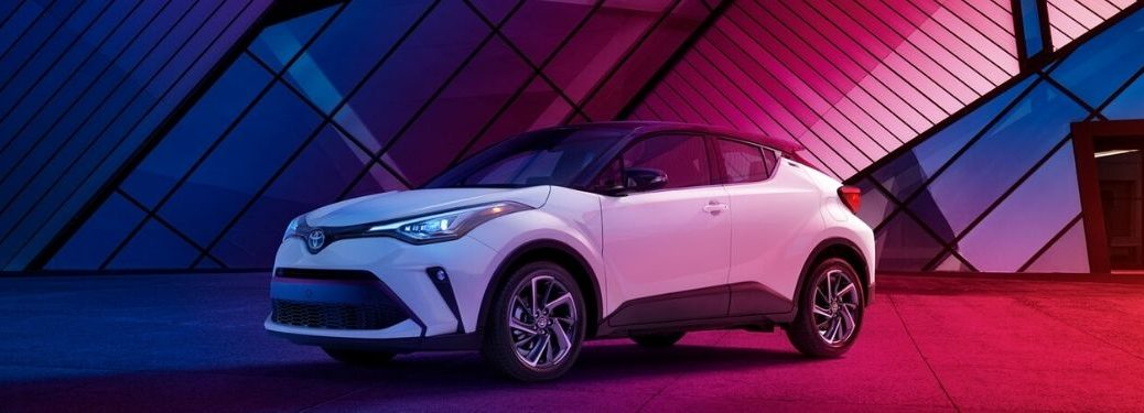 White 2020 Toyota C-HR in Front of Modern Building at Night