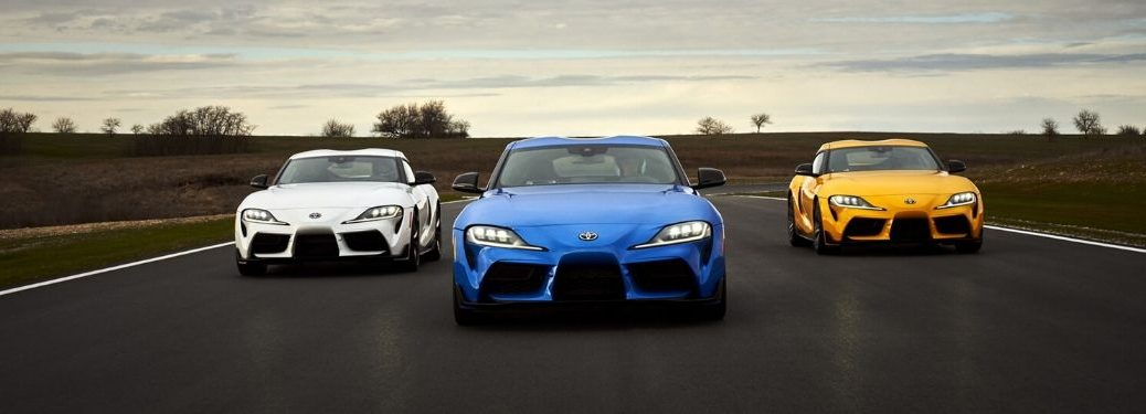 White, Blue and Yellow 2021 Toyota GR Supra Models on the Track