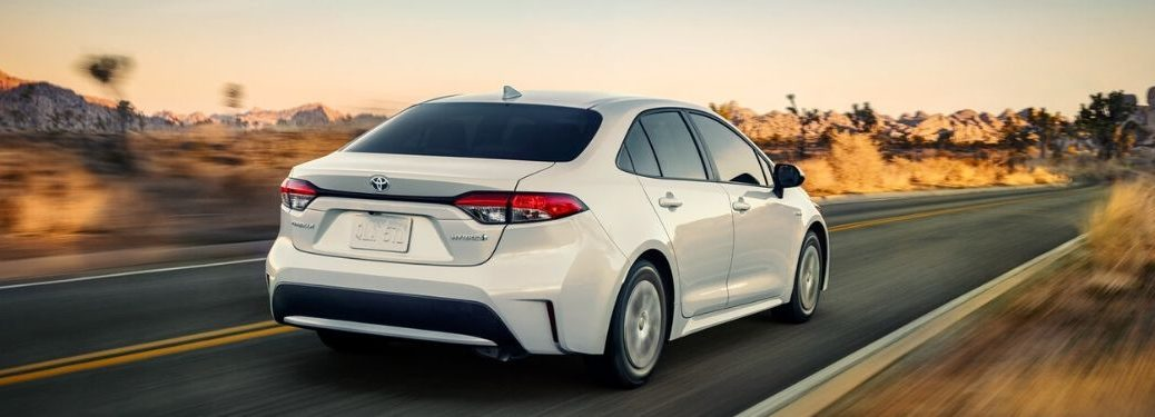 White 2020 Toyota Corolla Hybrid Rear Exterior on a Desert Highway