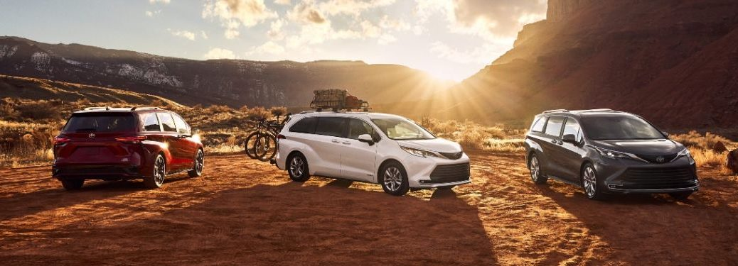 Red, White and Gray 2021 Toyota Sienna Models in the Desert at Sunset