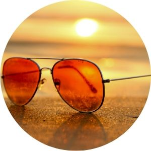 Close Up of Sunglasses on a Beach at Sunset