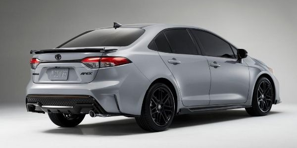 Silver 2021 Toyota Corolla Apex Edition Rear Exterior on Gray Background