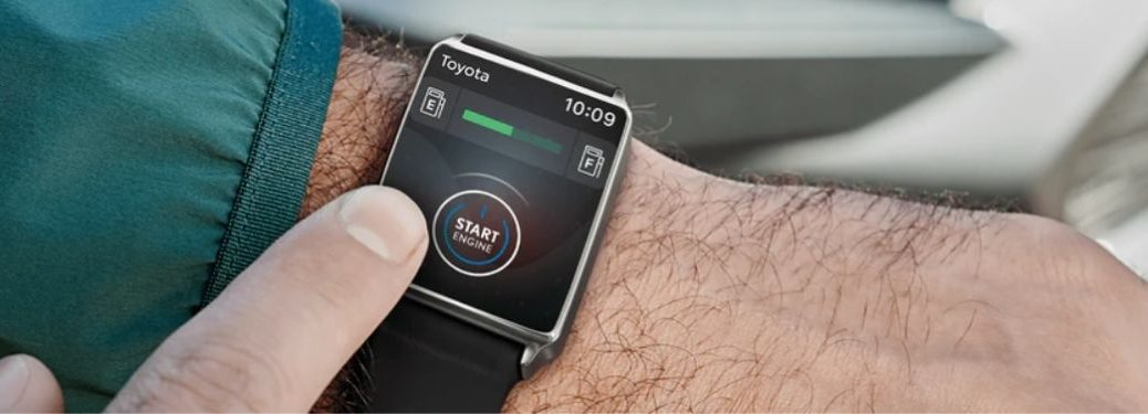 Close Up of Man Using Toyota Remote Connect with a Smartwatch
