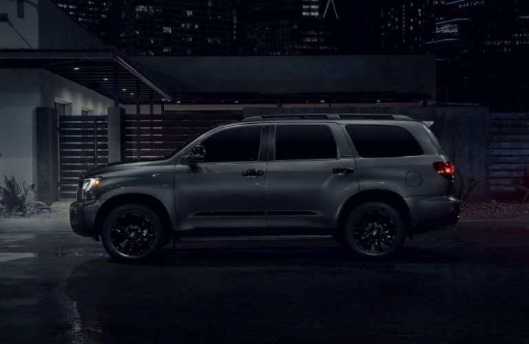 Gray 2021 Toyota Sequoia Nightshade Edition Side Exterior on a City Street at Night