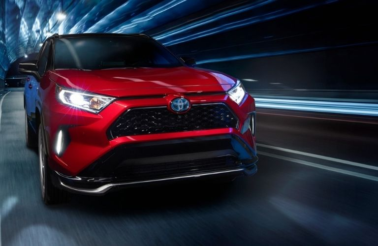 Red 2021 Toyota RAV4 Prime in a Tunnel