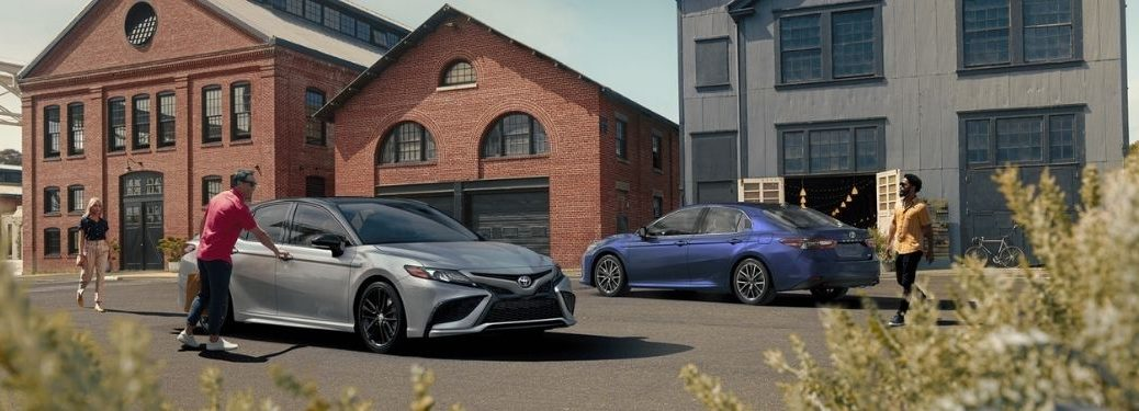 Blue and Silver 2021 Toyota Camry Models in a Parking Lot