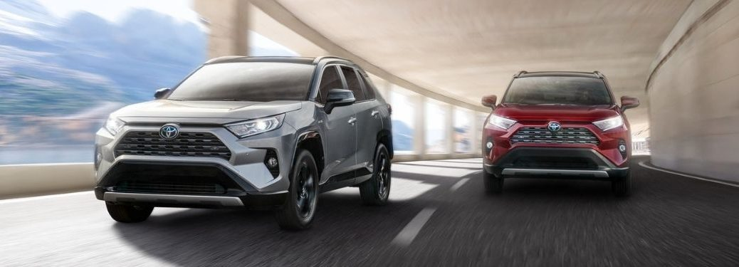 Silver and Red 2021 Toyota RAV4 Models in a Tunnel