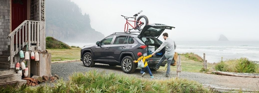 Father and Son Load Cargo in a Gray 2021 Toyota RAV4