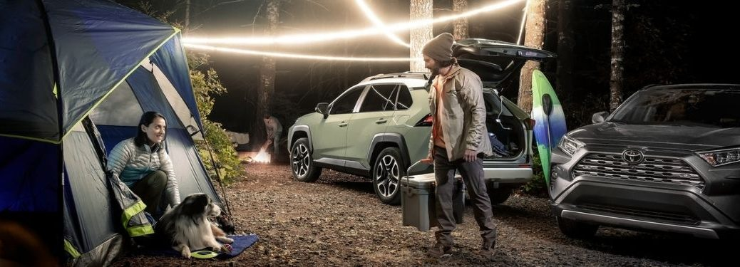 Family and 2021 Toyota RAV4 at Campsite