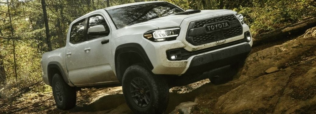 White 2021 Toyota Tacoma TRD Pro on a Forest Trail