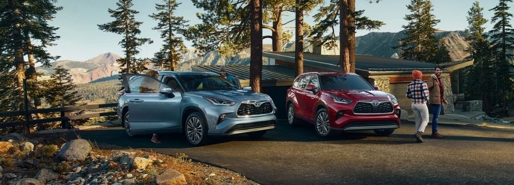 Blue and Red 2021 Toyota Highlander Models in a Driveway