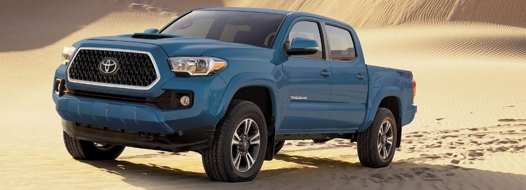 Blue 2019 Toyota Tacoma in a Desert