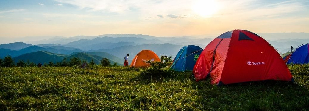 Tents on the Side of a Mountain at Sunrise