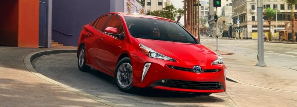 Red 2022 Toyota Prius Front Exterior on a City Street