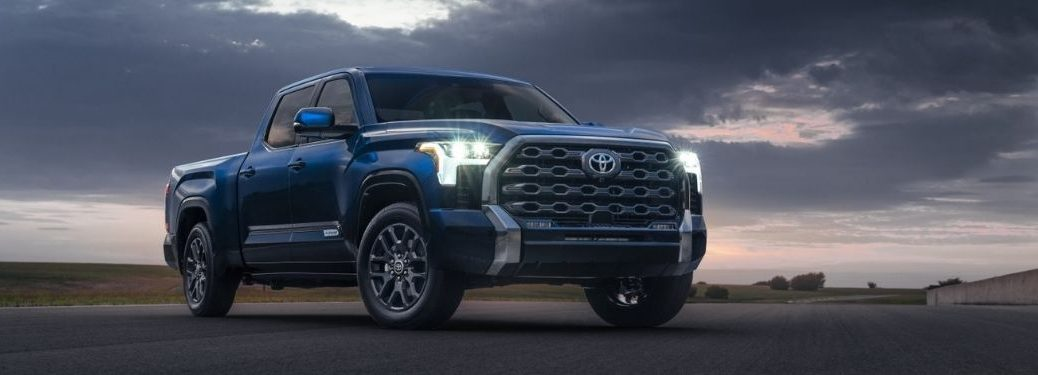 Blue 2022 Toyota Tundra Front Exterior on Desert Road at Night