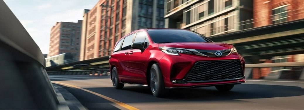 Red 2022 Toyota Sienna on a City Street
