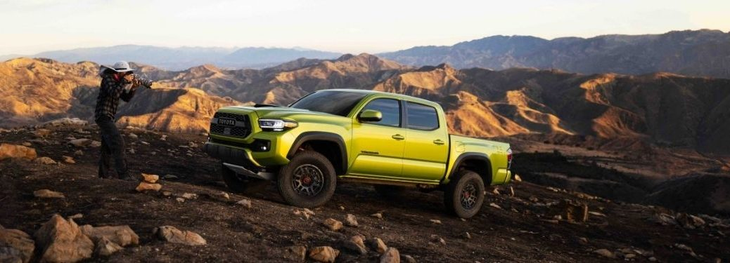 Electric Lime Metallic 2022 Toyota Tacoma and Photographer on Rocky Trail