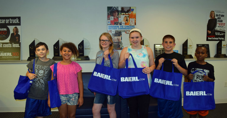 kids with Baierl gift bags