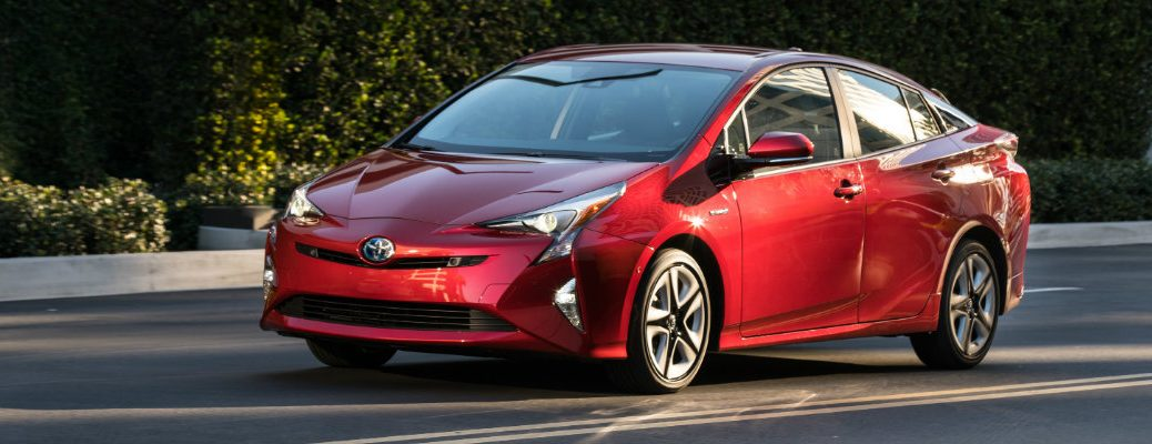 red-2017-Toyota-Prius-driving