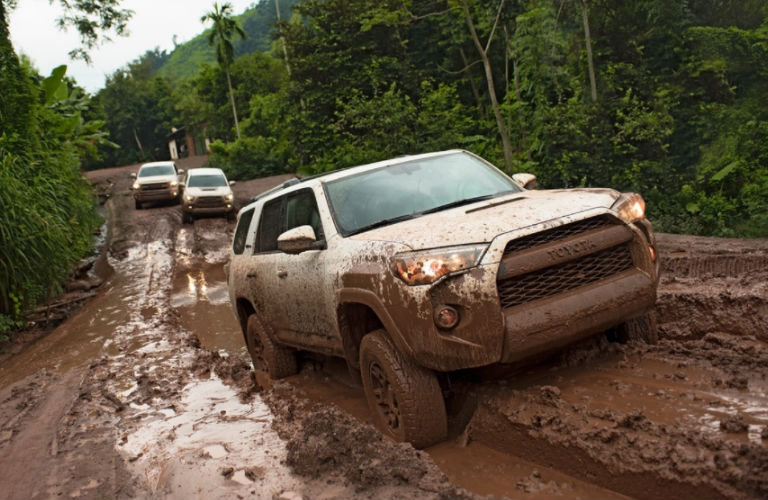 Three 2018 Toyota 4Runner TRD Pro models in the mud