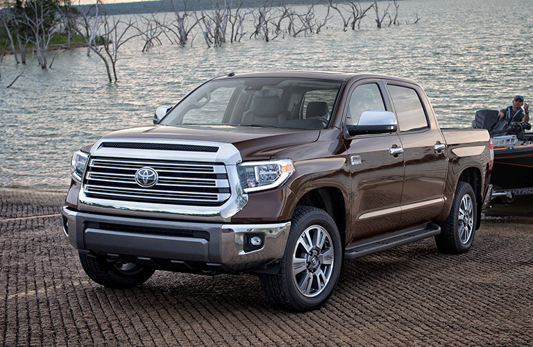 2019 Toyota Tundra in gray with trailer by a lake