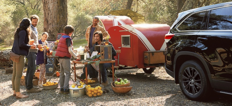 Family camping with a black 2019 Toyota Highlander