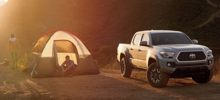 2019 Toyota Tacoma gray front view in front of a tent