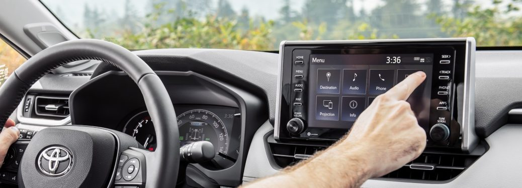 2019 Toyota RAV4 touchscreen with man operating it