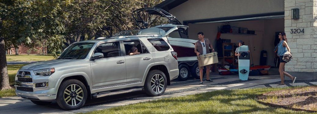 2019 Toyota 4Runner silver side view with a family