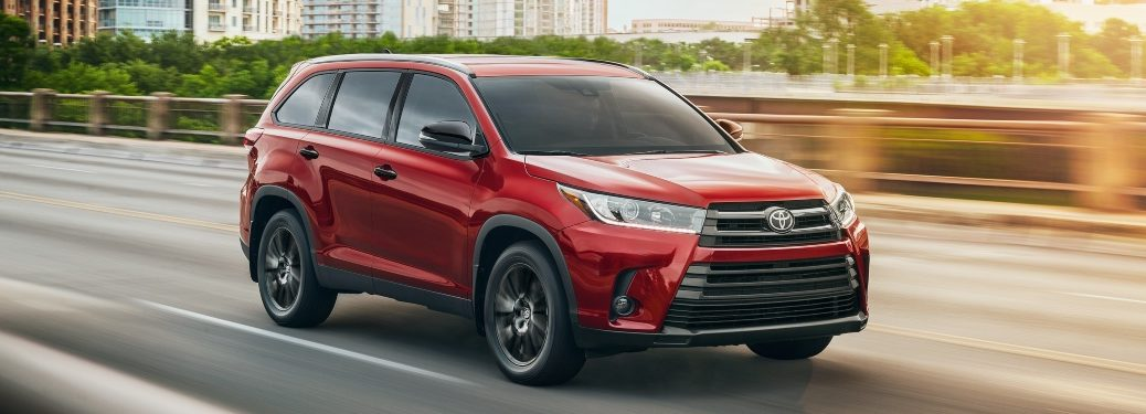 2019 Toyota Highlander red side view on the road Nightshade Edition