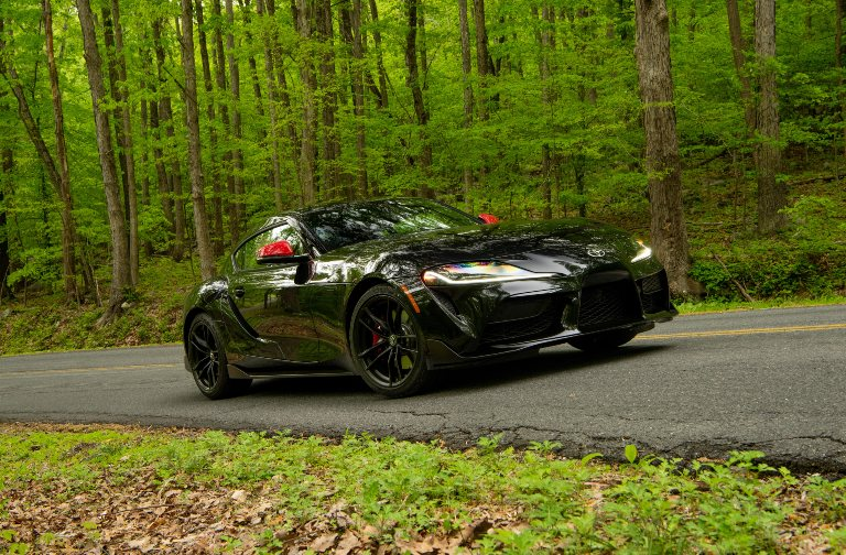 2020 black toyota supra driving in forest