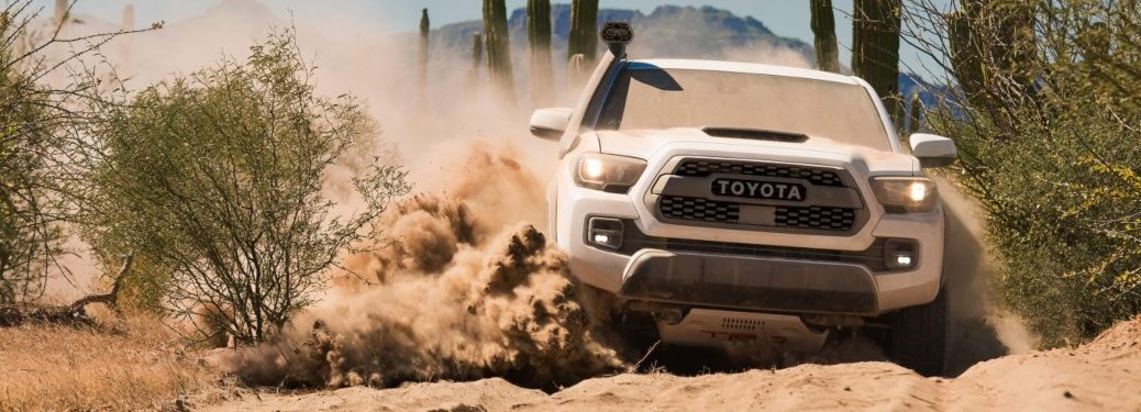2019 Toyota Tacoma TRD Pro white front view sliding in sand