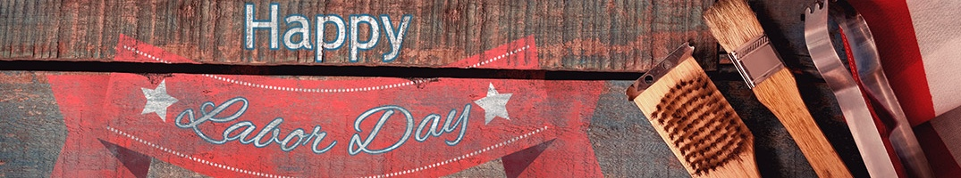 Happy Labor Day on a wood background with grill implements